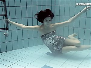 Loris blackhaired teenage swirling in the pool