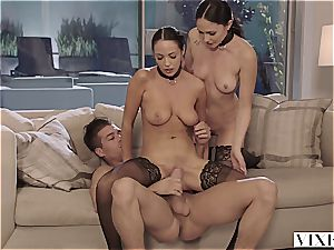 2 victims on leashes squirm on a gigantic rod