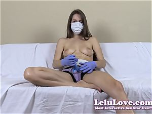 bra-less female with medical mask and strapon