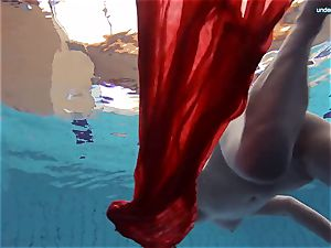 red clothed teenager swimming with her eyes opened