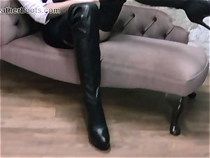 gorgeous assistant leisurely pulls on her leather hip footwear