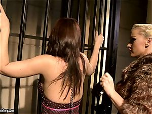 Kathia Nobili in wooly jacket tormenting a super-steamy babe