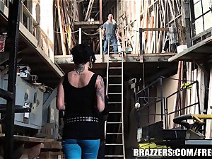 Eva backside pummeled in a warehouse