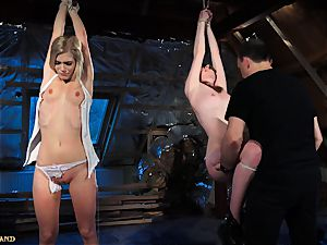 sadism & masochism punishing two teenage slaves using leather flog
