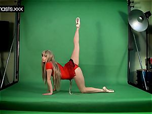 crimson clothed Gymnast Doing spreads