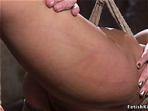 hog-tied in back bend dark haired flogged