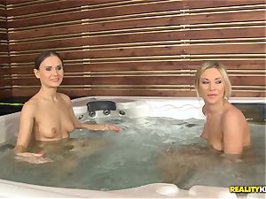 Sabina Moore and Lindsey Olsen getting freaky in the sizzling tub